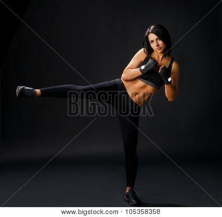 Young Sportive Woman Makes Tae Bo Side Leg Kick
