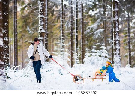 Father And Children Playing In Snow