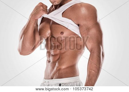 Sexy Muscular Fitness Man Showing Sixpack Muscles Without Fat