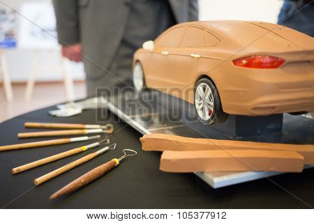 RUSSIA, MOSCOW -?? 4 DEC, 2014:  Ford car model made of clay, is on the table, next to lay tools at the press event for Ford in SREDA loft.