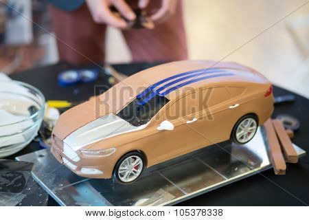 RUSSIA, MOSCOW -?? 4 DEC, 2014: Model of car with a metal plate and three blue stripes at the press event for Ford in SREDA loft.