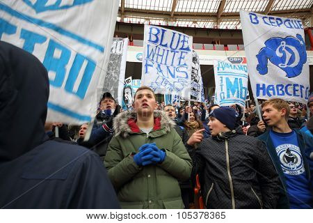 MOSCOW, RUSSIA - NOV 02, 2014: Fans with banners and fans cheerleader of Dinamo on grandstand of Locomotive stadium during game.