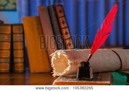 Red quill pen black inkwell and a rolled papyrus leaf on an old book with a blue background poster
