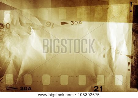 Film negative frames on brown paper poster