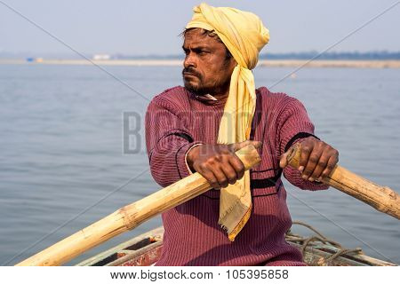 Indian Boatman On The Ganges River, Varanasi, India