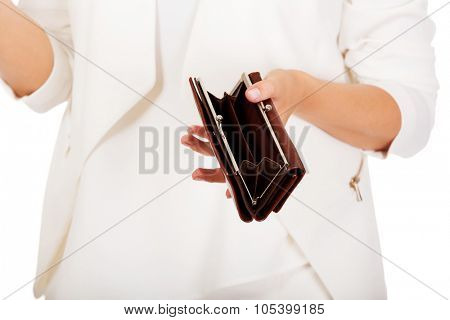 Young businesswoman holds empty wallet.
