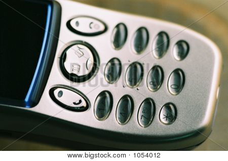 detail of a mobile phone keypad in diffused light poster