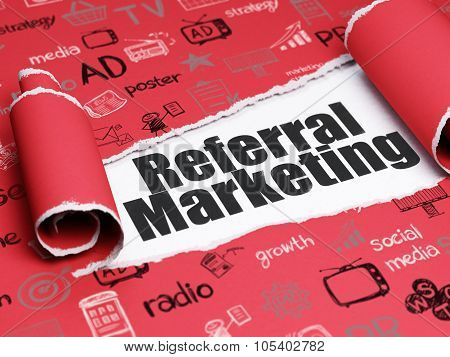 Advertising concept: black text Referral Marketing under the piece of  torn paper