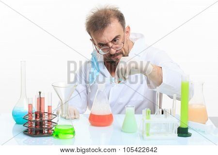 Mad chemist in the lab doing reaction - studio shoot poster