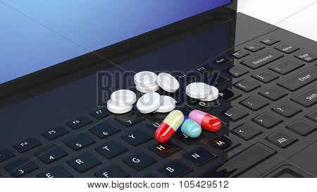 Pills on laptop keyboard, isolated on white background.