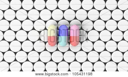 Colorful caplets on top of white round pills background.