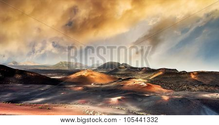 beautiful mountain landscape with volcanoes in at sunset Timanfaya National Park in Lanzarote, Canary Islands