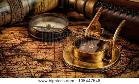 Travel geography navigation concept background - panorama of old vintage retro compass with sundial and spyglass on ancient world map with copyspace