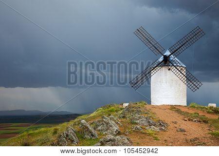 Old Windmill on dramatic sky and rain, Campo de Criptana, Castilla la Mancha province, Spain, Europe