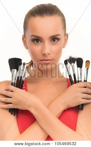 Girl with brushes for make-up.