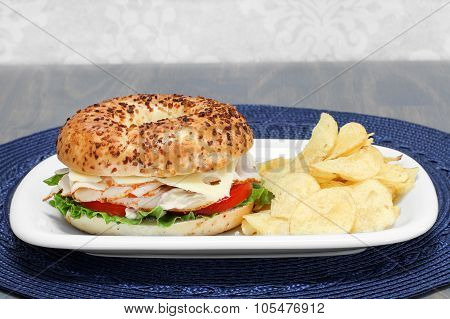 Turkey, Swiss Cheese, Tomato And Lettuce Sandwich On An Onion Bagel.