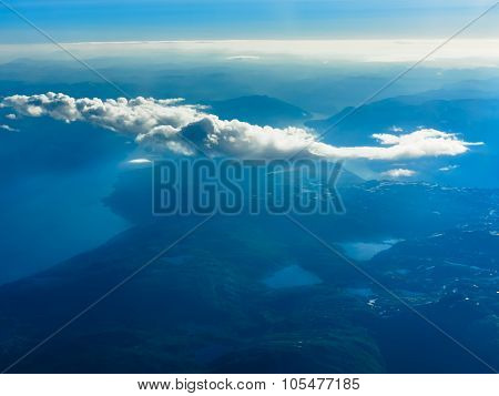 Birds eye. View from window of plane airplane flying over fjords Norway Scandinavia. poster