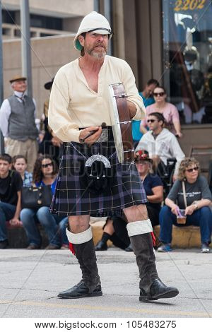 Galveston, Tx/usa - 12 06 2014: Male Musician In Traditional Scottish Costume Plays Drum At Dickens