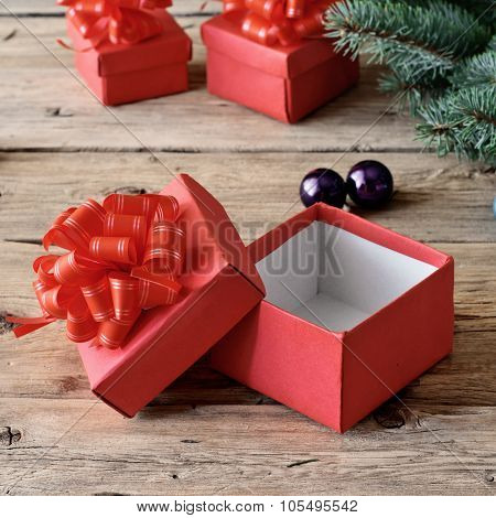Open Christmas Box On A Wooden Table