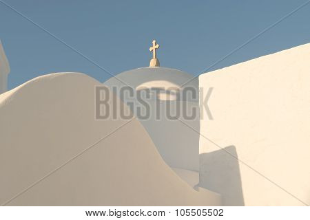 White church with light blue trulli at Paros island in Greece.