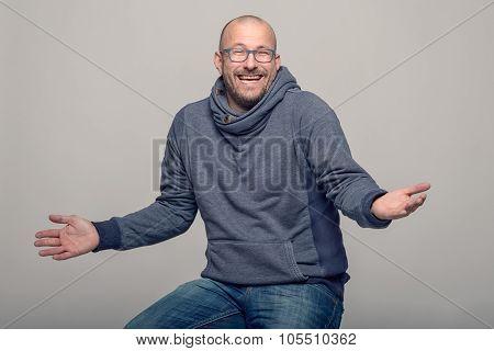 Charismatic Man Shrugging His Shoulders