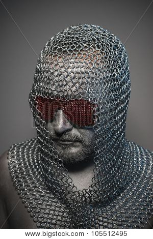 Shield, man in chain mail and leather painted silver, medieval warrior