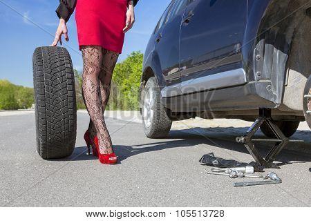 Sexually dressed woman repairing car