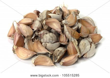 The Cloves Of Garlic On White Background