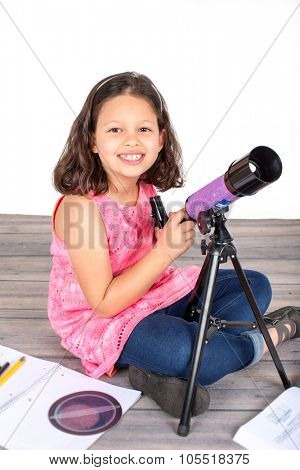Little girl holding her telescope