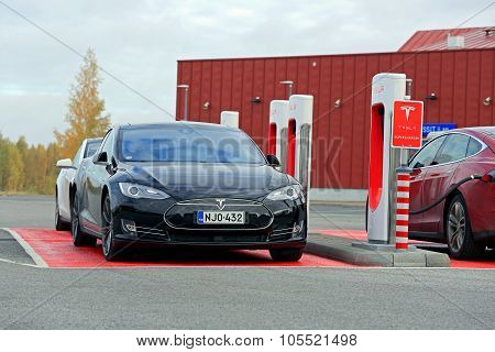 Tesla Model S Cars At A Supercharger Station