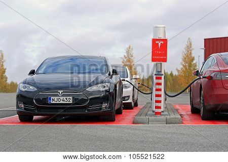 Tesla Model S Cars Plugged In At Supercharger Station
