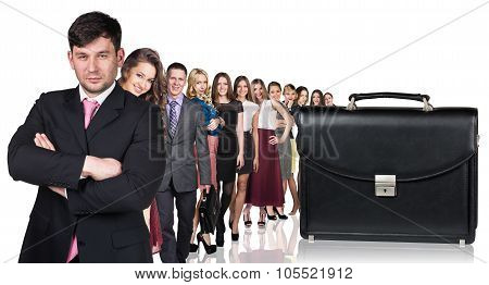 Black briefcase foreground and business peole