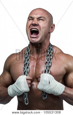 Aggressive bodybuilder holding chain against white background poster