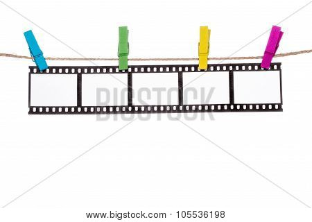 colorful clothespins on a clothesline hanging Photographic Negatives image poster