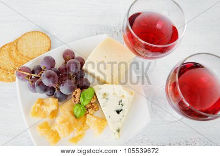 Cheese Platter And Two Glasses Of Red Wine