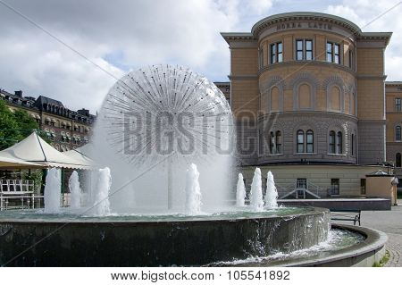A fountain in front of Norra Latin conference center Stockholm poster
