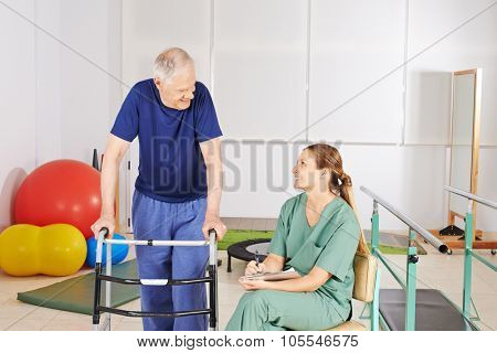 Old man with walker in physical therapy in a nursing home
