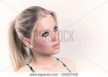 Portrait Of Sporty Blonde Girl. Faraway Look.