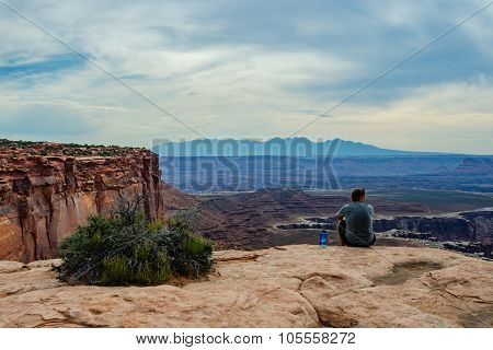 Male Hiker Takes In Grand View In Canyonlands National Park