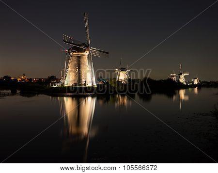 Windmills Lit At Night