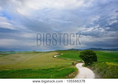 Winding Road To A Destination In Tuscany