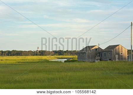 Virginia Wetlands With Lighthouse And Boathouse