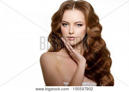Model with long hair. Waves Curls Hairstyle. Hair Salon. Updo. Fashion model with shiny hair. Woman with healthy hair girl with luxurious haircut. Hair loss Girl with hair volume.