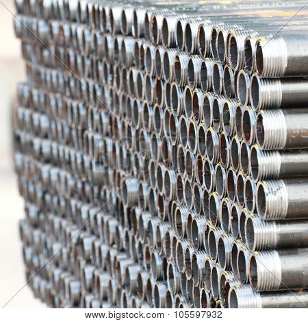 stack of threaded pipes