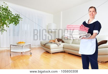 Maid woman with towels. House cleaning service concept.