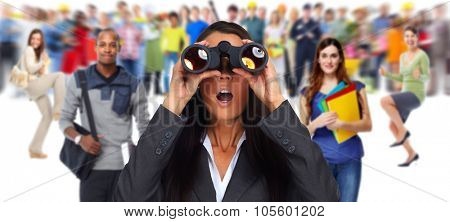 Business woman with binoculars. Job search concept background.