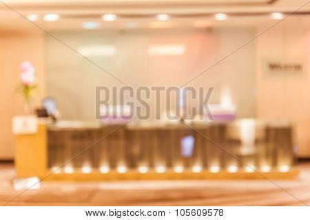 Blurred Photo Of Registration Desk/ Reception Desk Of Hotel Meeting Room Function.