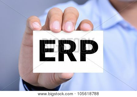 ERP letters (or Enterprise Resource Planning) on the card shonw by a man poster