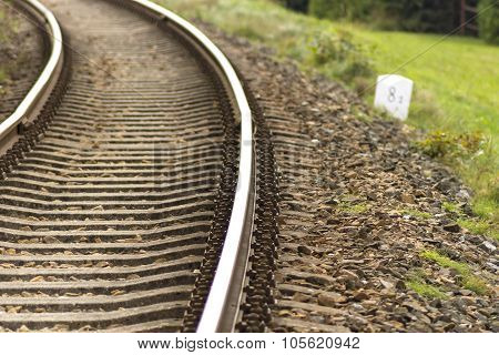 Train Tracks With White Milestones