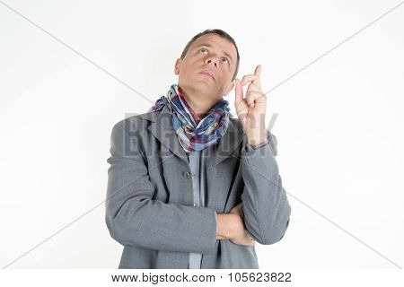 Charming And Handsome Man With Casual Jacket Pointing His Finger Up Isolated
